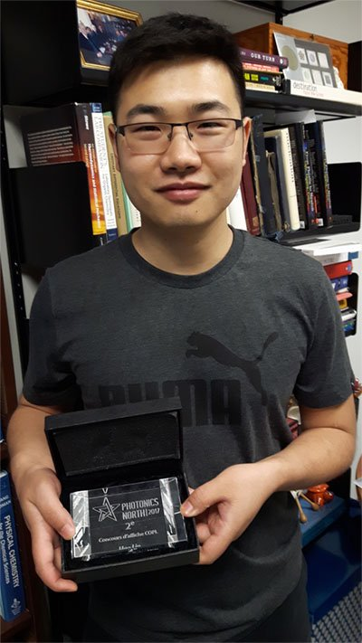 Halo Lin holding his Prize
